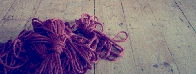 Red coils of rope on the floor (rope banner)