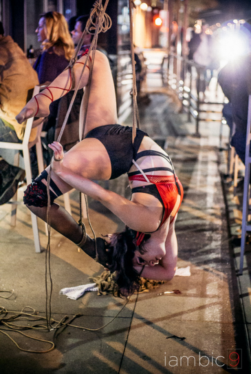 Bendy circus aerialist in circusy self-suspension