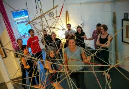 People smiling posing with rope in the studio