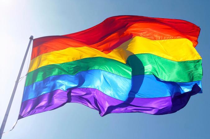 """""""Rainbow flag, sun, wind, and blue sky"""""""